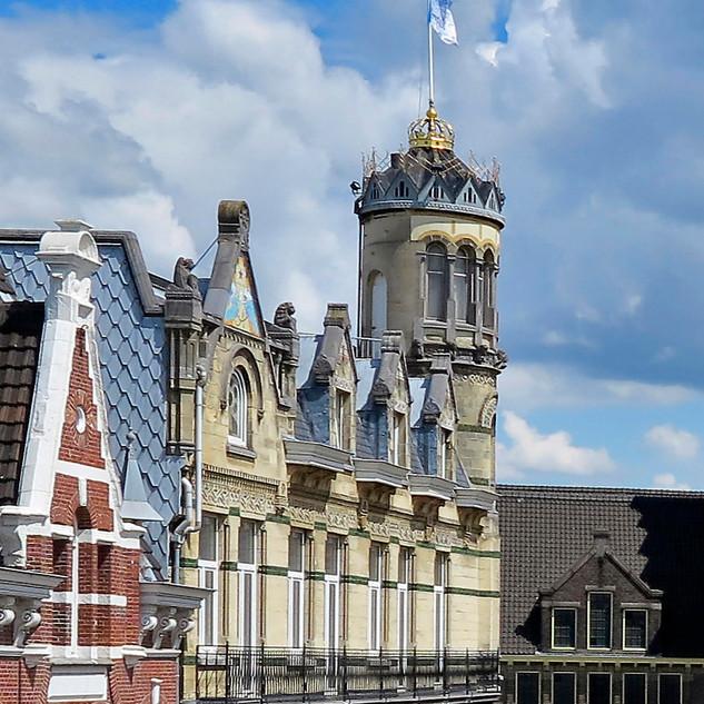 Motto- De kroon op het dak