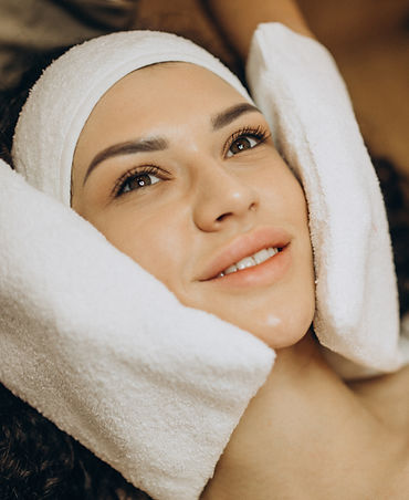 woman-cosmetologist-making-beauty-proced