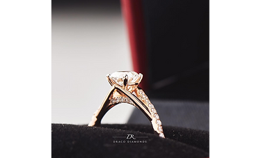 An engagement ring set in 18K rose gold