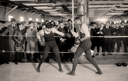 2 men box in London in the late 1800's in front of a crowd
