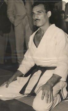 A man wearing a gi stares at the camera