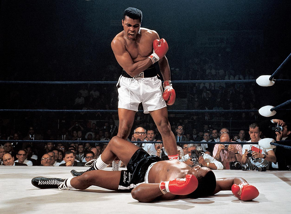 Muhammad Ali stands over Sonny Liston after knocking him down