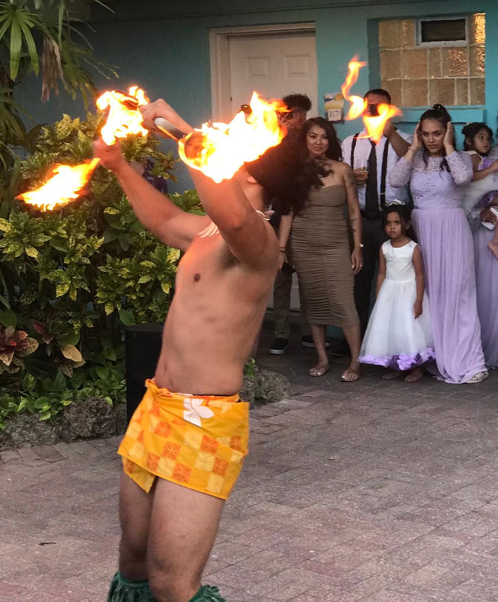 Hula Dancer with torches-Destination Wedding-Gulf Beaches Weddings