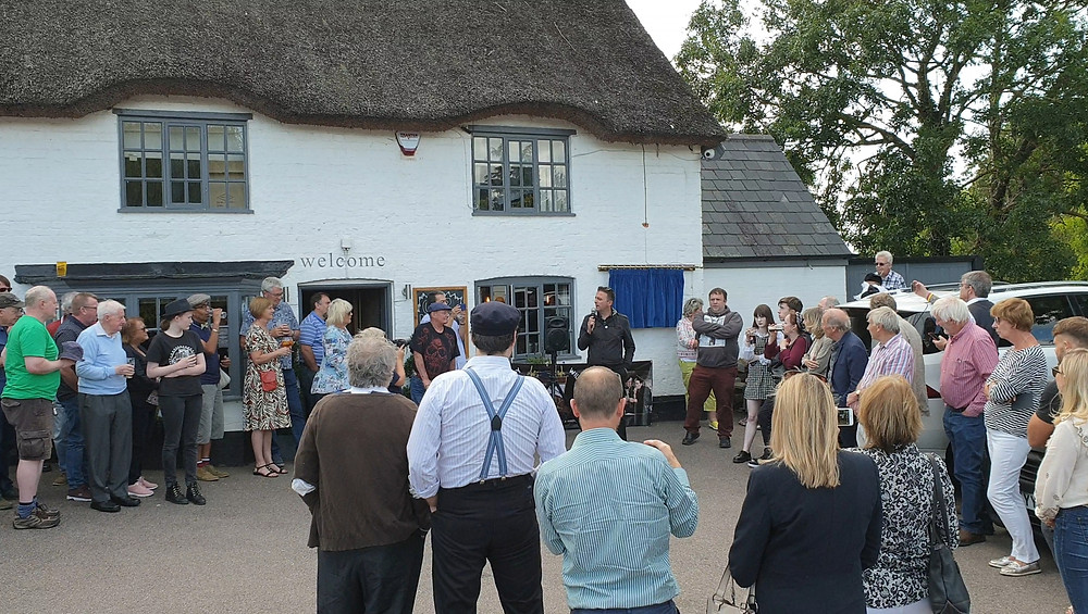 Film historian Graham Rinaldi addresses the crowd of onlookers at the Swan, Braybrooke.
