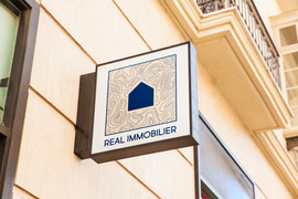 LOGO - REAL IMMOBILIER