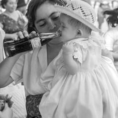 Baby Drinking Coke in Merida