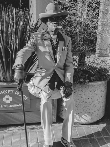 Man with Cane and Cigars