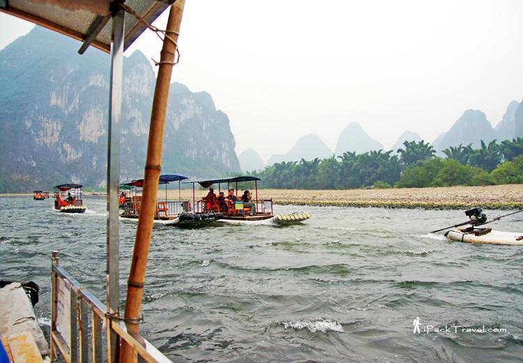 Raft going upriver using motor power