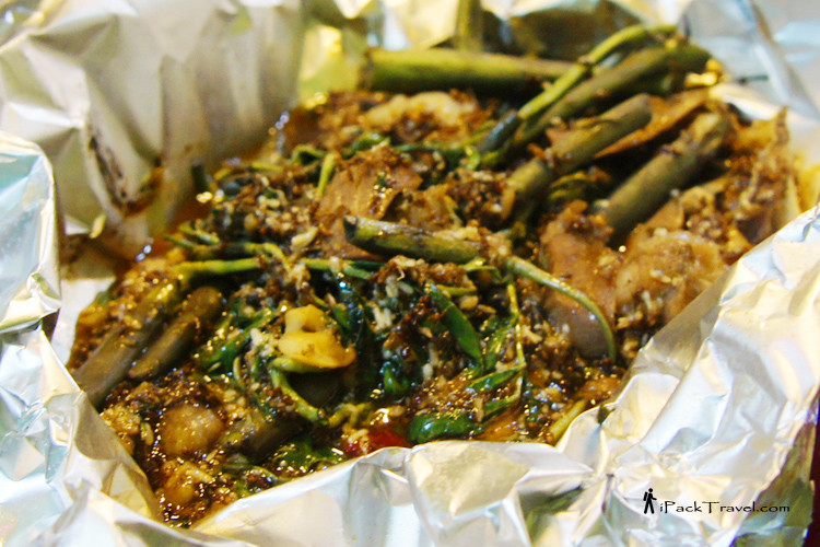 Stir-fried beef with kangkong and big red ants