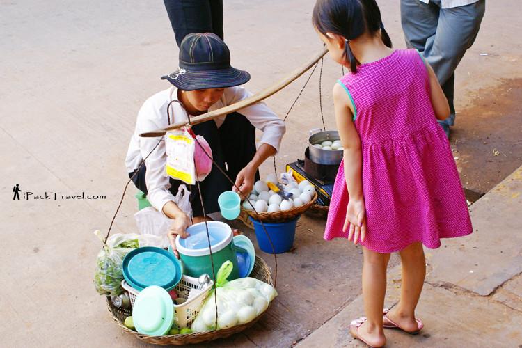 Girl buying balut