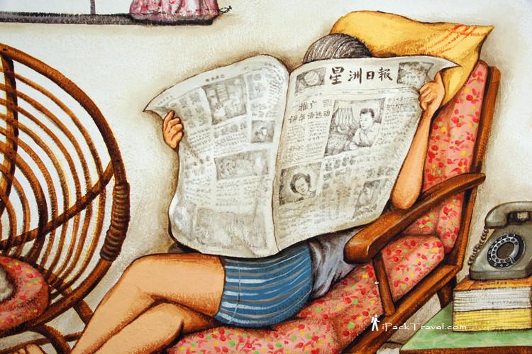 Read newspaper on sofa