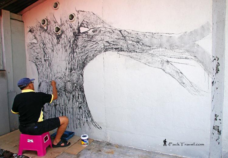 Artist painting a rain tree