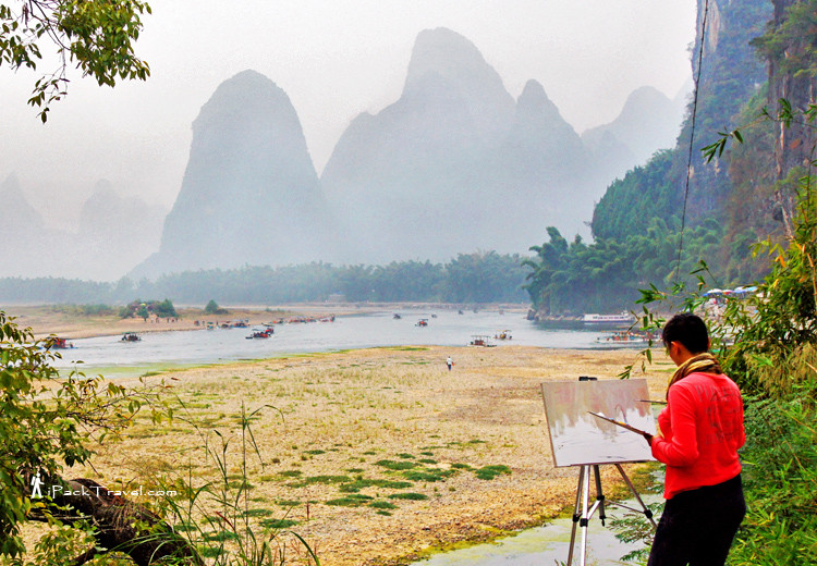 Lady painting Guilin scenery