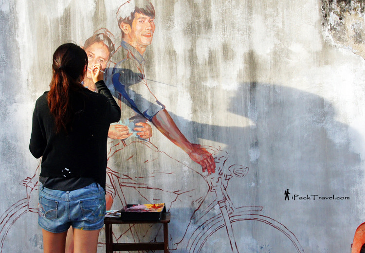 Girl painting mural