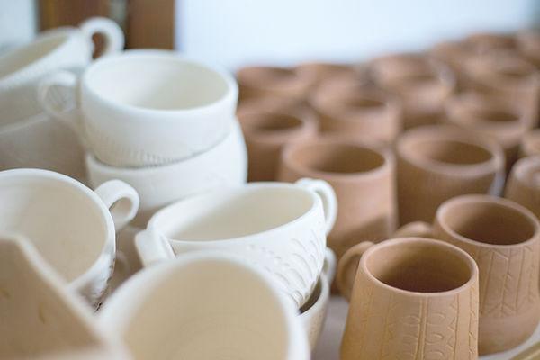 Clay krus og kopper