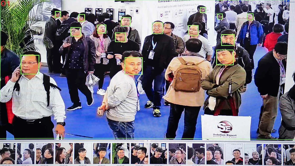 A screen shows visitors being filmed by AI (artificial intelligence) security cameras with facial recognition technology at the 14th China International Exhibition on Public Safety and Security at the China International Exhibition Center in Beijing on October 24, 2018.   NICOLAS ASFOURI / Contributor/ Getty Images