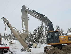 Excavator attachment drill