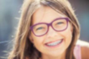 Ortho Kid with Purple Glasses.jpg