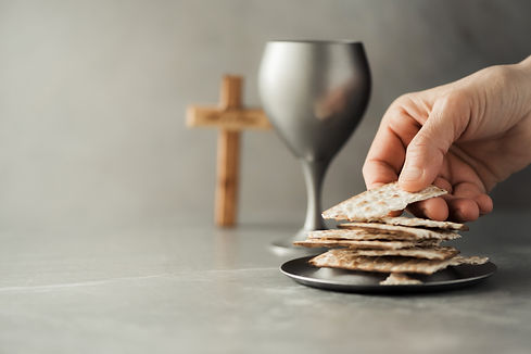 hands-with-chalice-and-communion-matzo-b