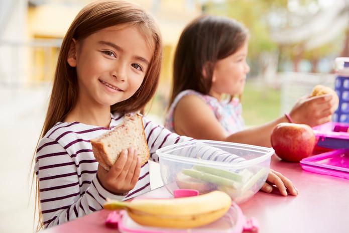 elementary-school-girls-eating-at-school