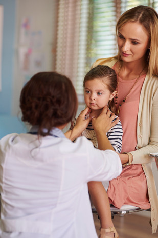 female-doctor-checking-the-little-girls-