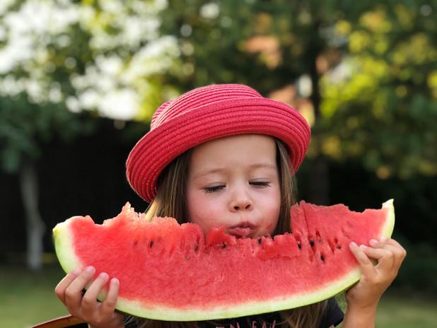 little-girl-is-eating-appetizing-waterme