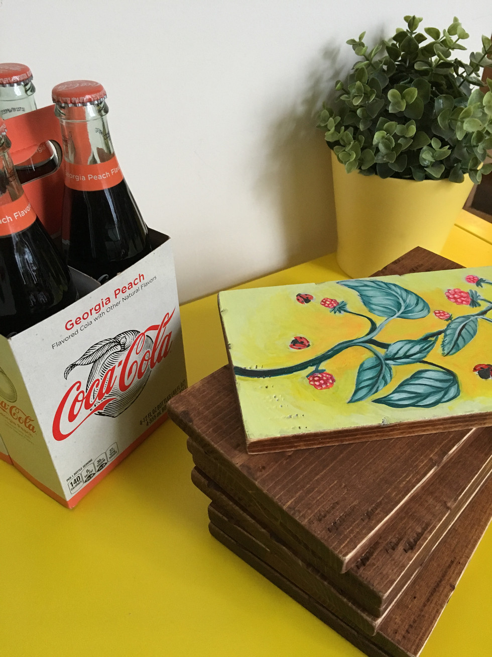 peach coke with yellow and paintings