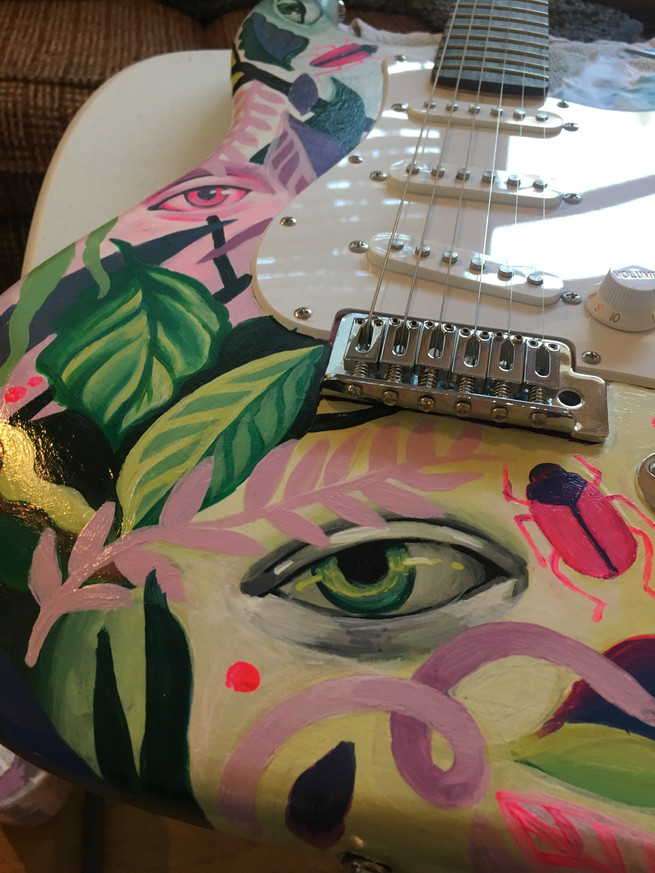 detail of painted eye and foilage on cathryn bozone man of the match guitar