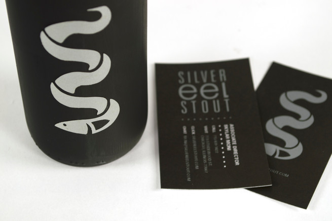 detail of silver eel stout business cards and logo