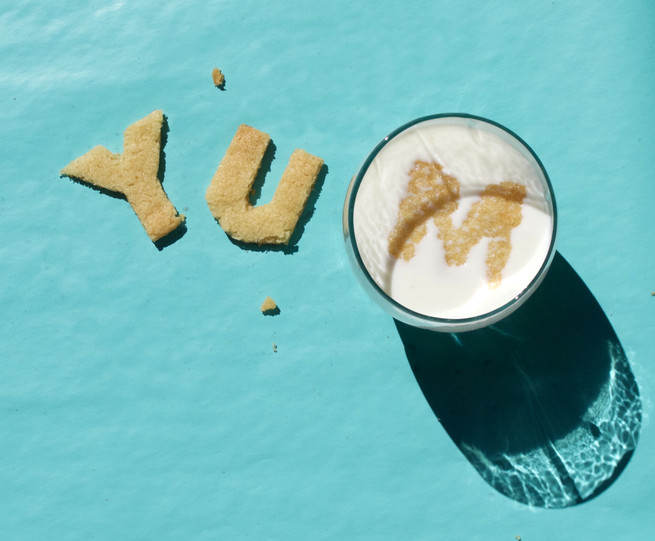 food typography design with cookies and milk
