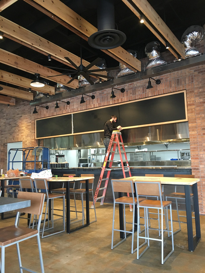 Sweetwater brewing company taproom chalkboard in process by cathryn bozone