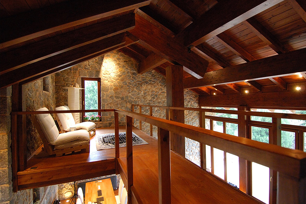 Loft space with exposed structure wooden roof