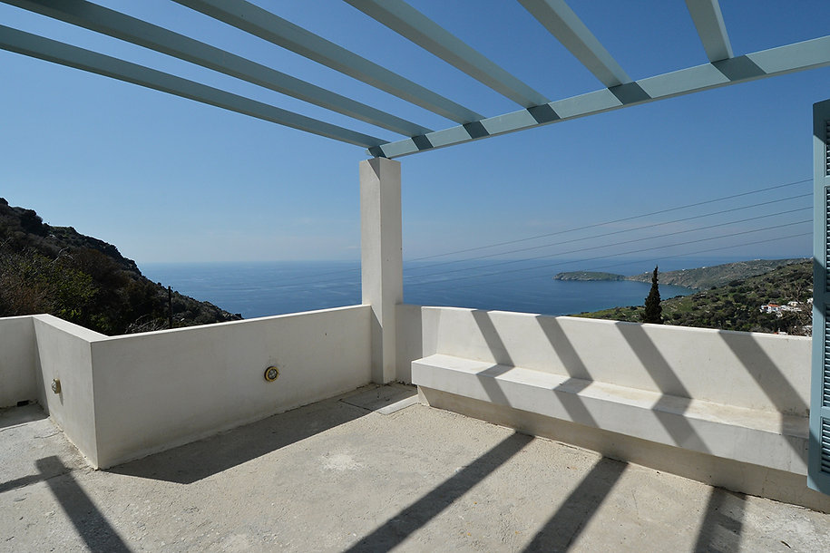 Blue pergola overlooking the Aegean