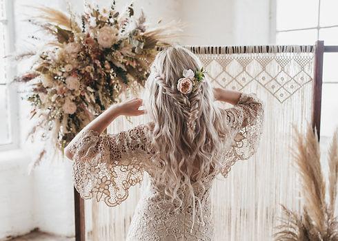 Hero image - boho shoot, half up half down braided hairstyle with dried flower installatio