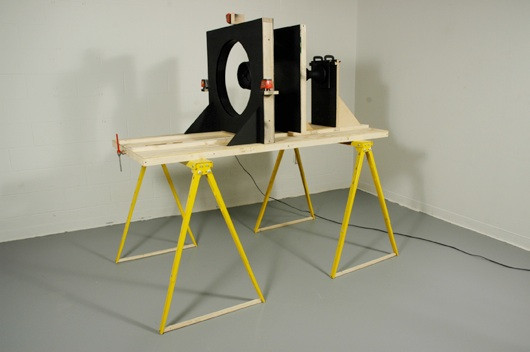 Visible Object, altered lamp, wood, steel, laser levels, and video projection   H 6' x L 6' x D 2'