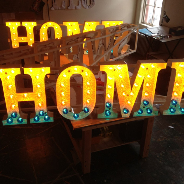 Home Sweet Home (Process), Hand-formed steel letters, cabochon carnival lights, light chaser circuit H 2' x L 25' x D 1'