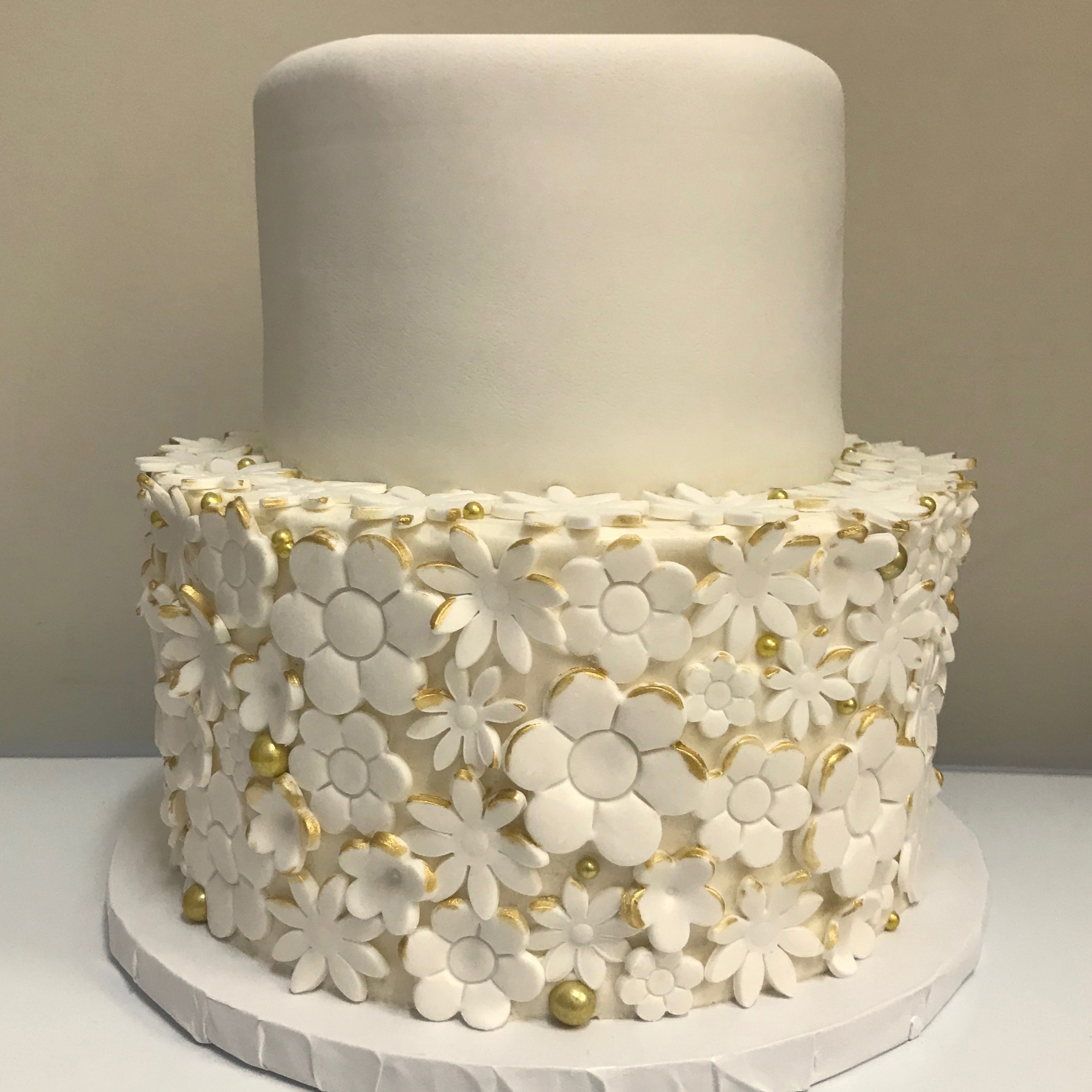 Flowers and gold sugar pearls
