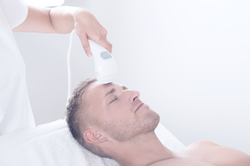Young_Man_Receiving_Laser_Hair_Removal_T