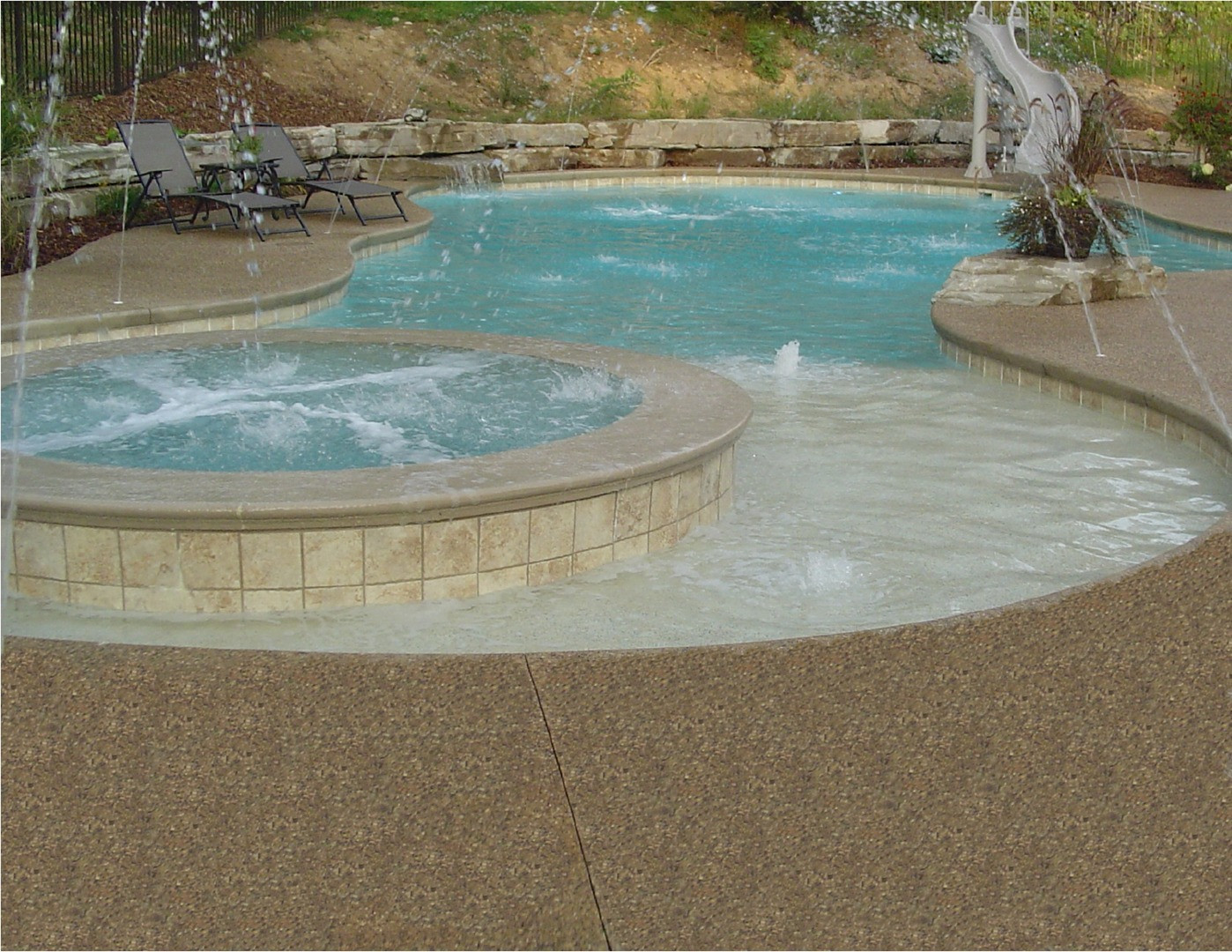 Exposed aggregate pool deck photo
