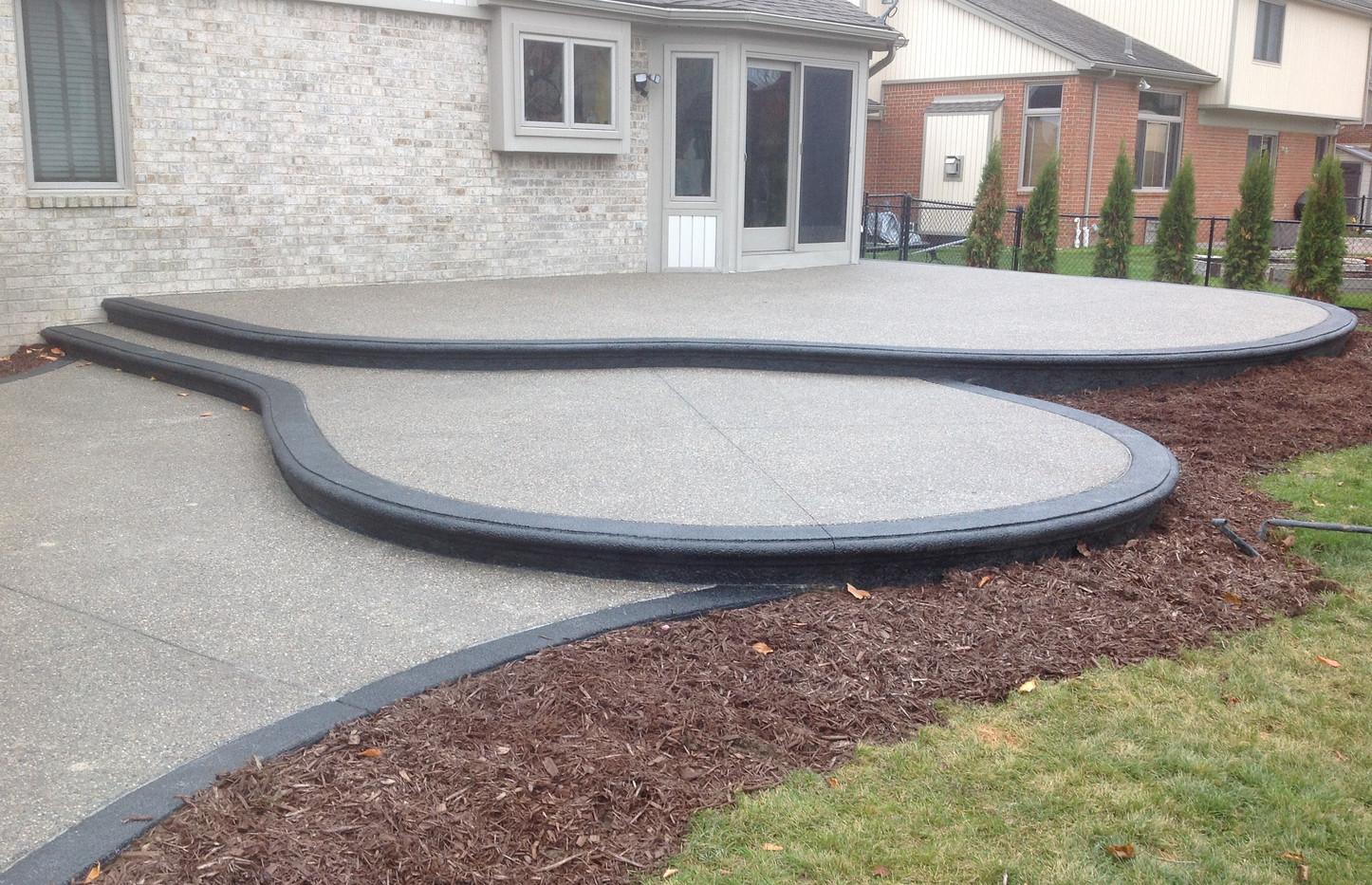 Exposed aggregate 2 tier patio photo Pot