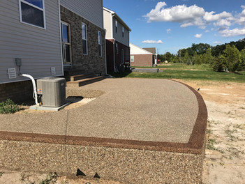 raised exposed aggregate patio photo