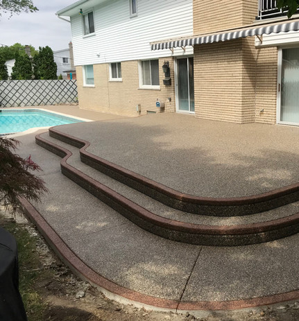 Exposed aggregate raised patio Potoroka