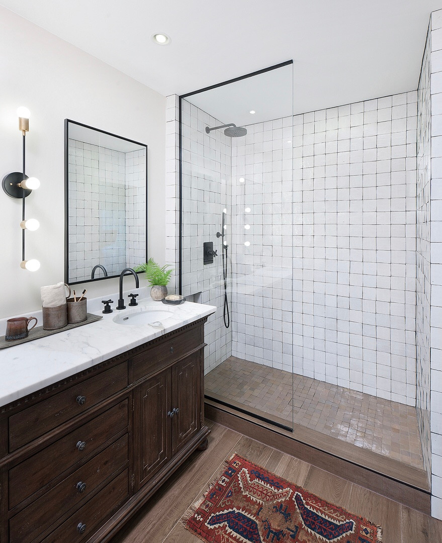 Rustic Modern Farmhouse Black & White Master Bathroom in Pittsburgh by Kelly Martin Interiors. Featuring Calacatta Countertops, Cle Tile Shower, Restoration Hardware, & California Faucets.