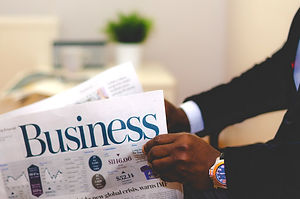 Businessman%20opening%20a%20paper_edited