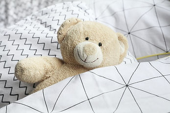 teddy bear in bed.jpg