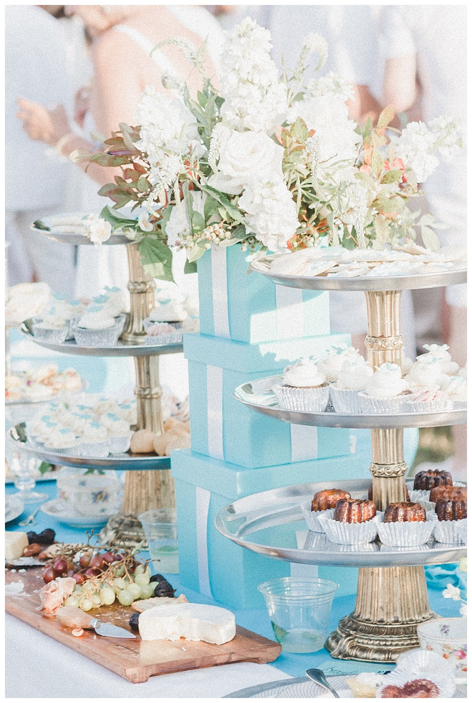 Tiffany's-inspired tablescape, cupcakes, cheese and crackers, blue presents centerpiece.  Fete en Blanc (Party in White) Lancaster 2019 at Longs Park by Angela Weiler Photography - Fine Art Wedding and Lifestyle Photographer in Lancaster Pennsylvania.