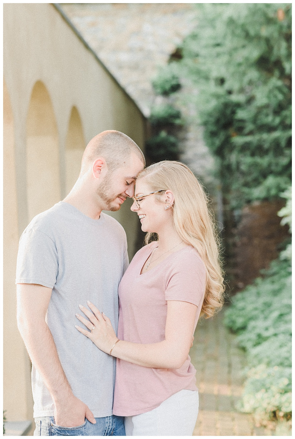 Couple forehead to forehead, gray shirt pink, Summer Engagement Session at Conestoga House and Gardens captured by Angela Weiler Photography - Fine Art Wedding and Lifestyle Photographer from Lancaster Pennsylvania.