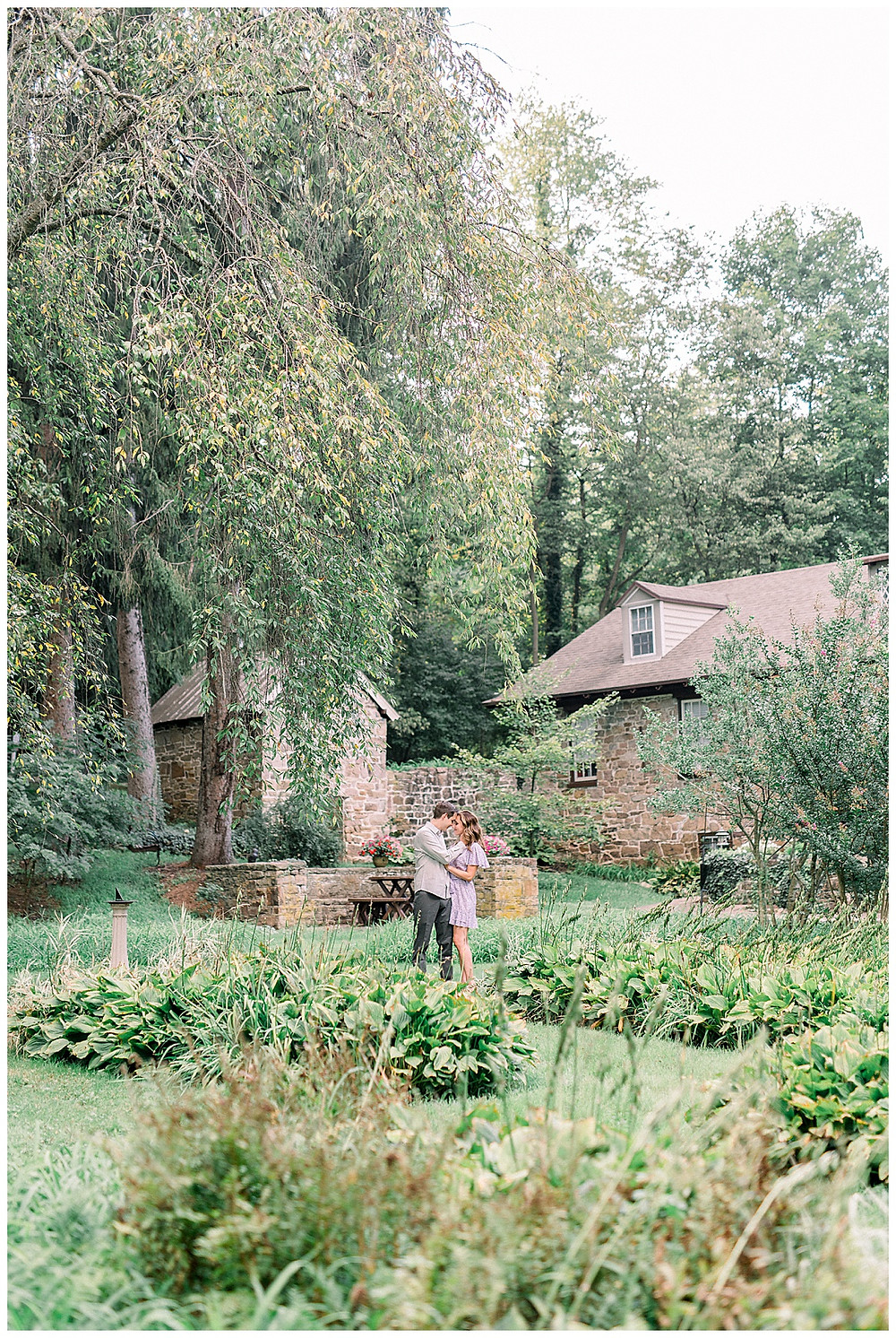 An engaged couple posing in Cottage core at Historic Shady Land