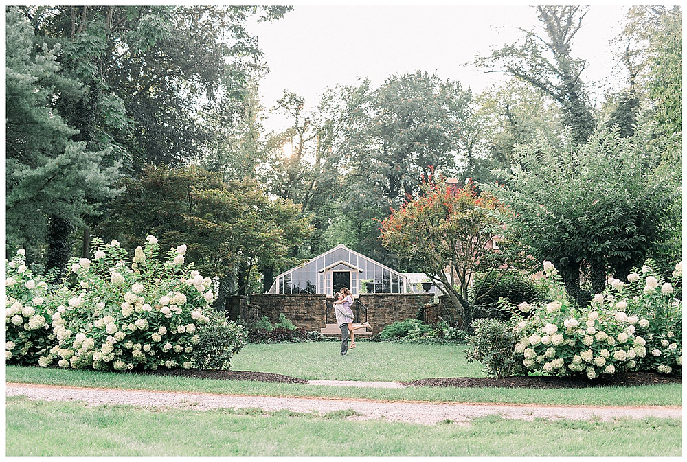 Pretty Garden with an engaged couple posing in the distance