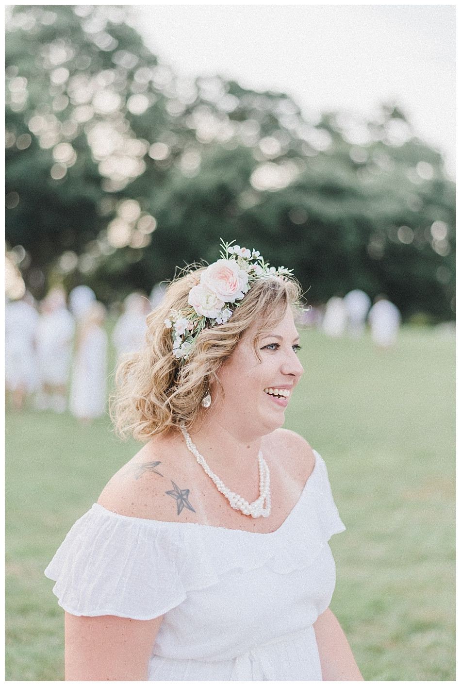 White dress, necklace, flower crown, laughing woman. Streamers released, portrait of young woman, large white balloons, red lipstick, flowers in her hair, white dress.  Fete en Blanc (Party in White) Lancaster 2019 at Longs Park by Angela Weiler Photography - Fine Art Wedding and Lifestyle Photographer in Lancaster Pennsylvania.